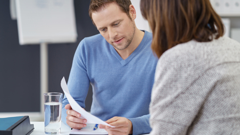 Man talking to women about debt counselling